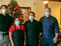 From left, Kyle Underwood, Candida Osilvo, Victor Caradilla, and Aboca's Italian Grill owner Artur Pira stand in Aboca's dining room on December 10, 2020. Aboca's is a restaurant in Richardson, a suburb of Dallas, Texas. (Hunter Lacey / Special Contributor)