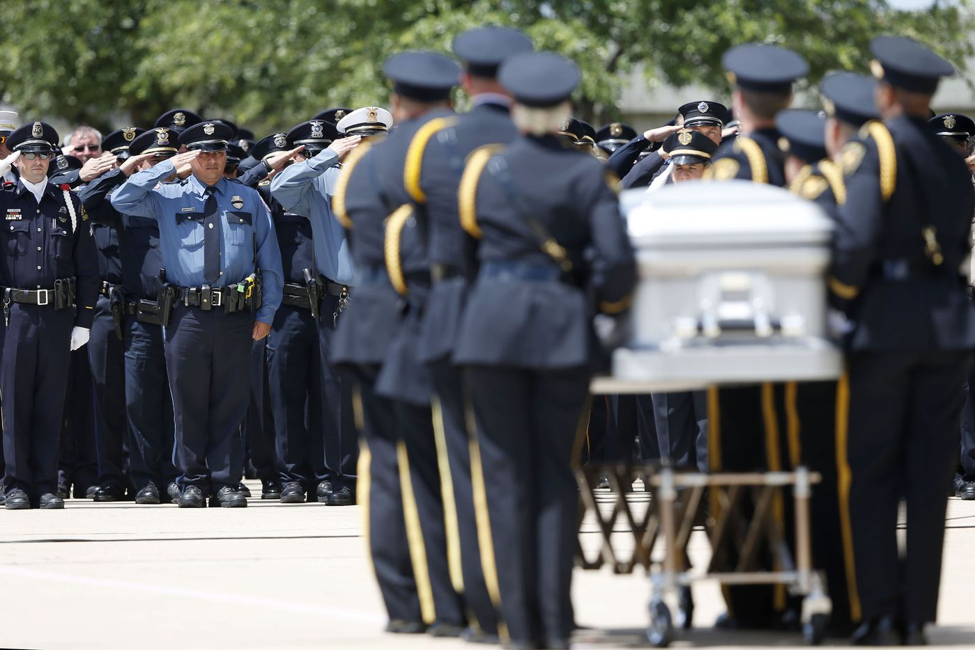 Arlington Honor Guard carry DART Officer Brent Thompson to the hearse during a memorial service at The Potter's House in Dallas on Wednesday, July 13, 2016. Thompson was one of five officers killed last week when a gunman opened fire during a Black Lives Matter rally in downtown Dallas.