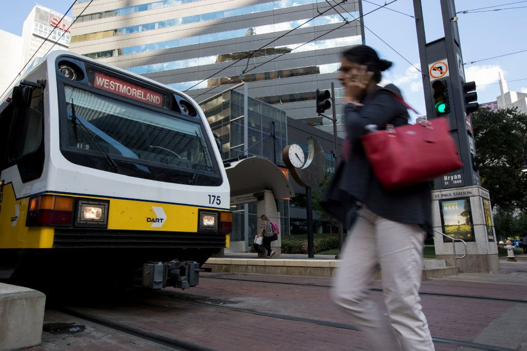 A passenger rushes to board the Red Line DART train at St. Paul Street DART station on Sept. 12, 2016 in Dallas.