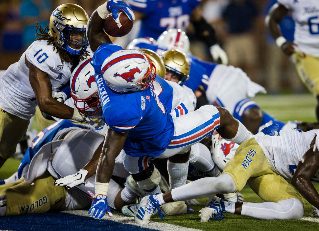 SMU Mustangs running back Ke'Mon Freeman (2) dives over the goal line for a touchdown during the fourth quarter of an NCAA football game between Tulsa and SMU on Saturday, October 5, 2019 at Ford Stadium on the SMU campus in Dallas. (Ashley Landis/The Dallas Morning News)