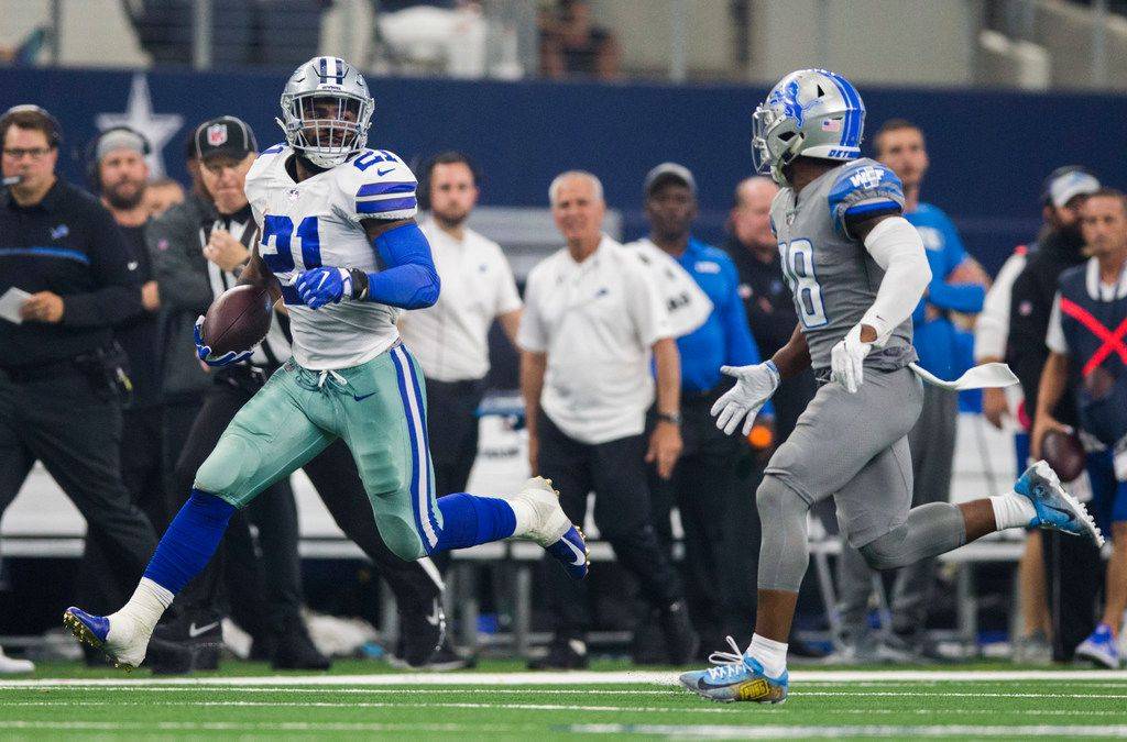 Dallas Cowboys running back Ezekiel Elliott (21) runs the ball ahead of Detroit Lions cornerback Quandre Diggs (28) during the second quarter of an NFL football game between the Dallas Cowboys and the Detroit Lions on Sunday, September 30, 2018 at AT&T Stadium in Arlington, Texas. (Ashley Landis/The Dallas Morning News)