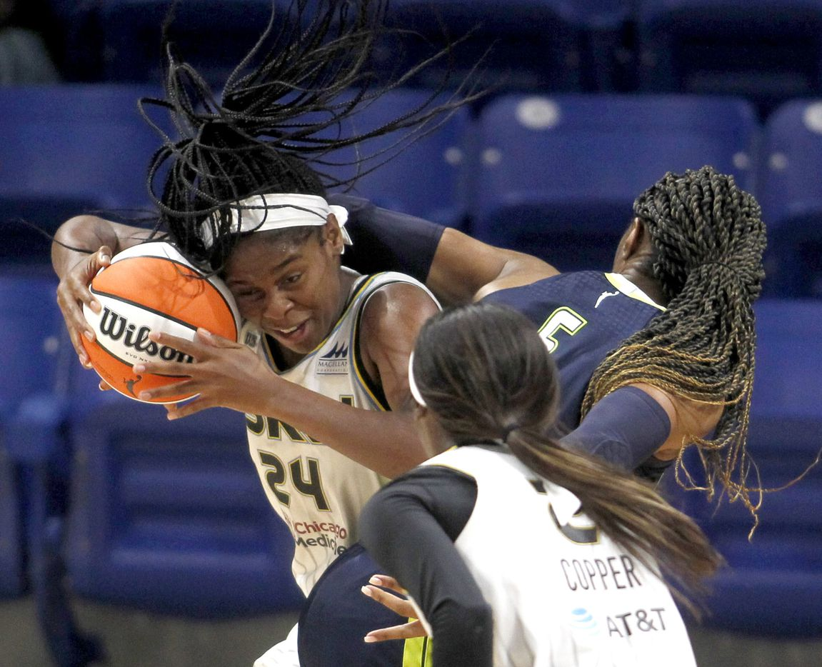 Chicago Sky forward Ruthy Hebard (24) gets tangled with Dallas Wings forward Kayla Thornton (6) during first half action. Thornton was called for a foul on the play. Chicago defeated Dallas 91-81. The two WNBA teams played their game at College Park Center in Arlington on June 30, 2021. (Steve Hamm/ Special Contributor)