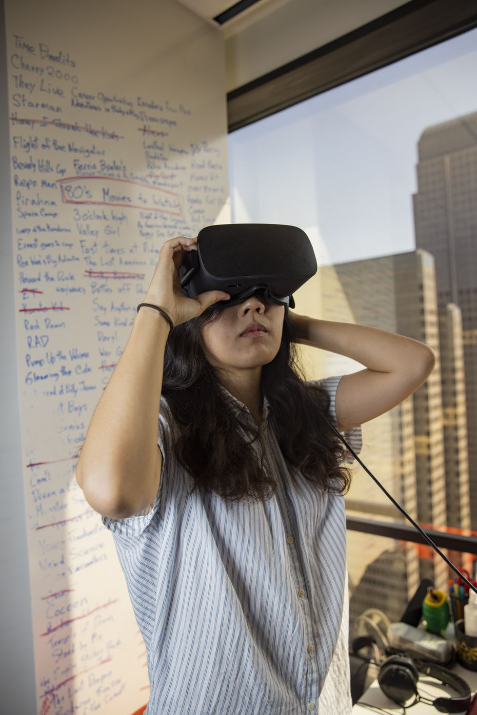 Ruby Wang, concept artist at Flight School Studio, wears a VR headset during a portrait session on July 9, 2020 in Dallas.