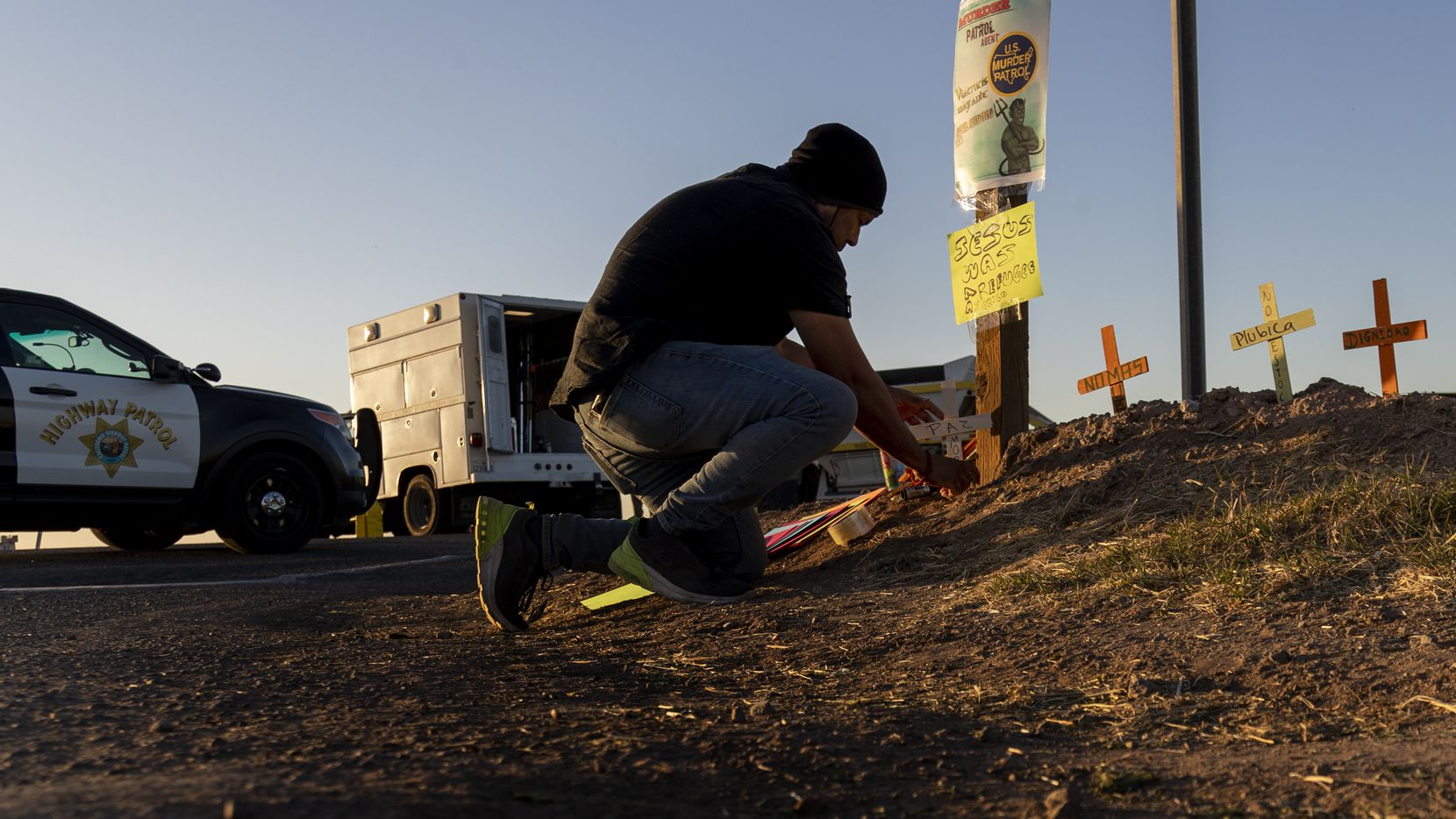 Hugo Chavez, an activist with the Coalition for Human Immigration Rights, placed crosses at the scene where an SUV carrying 25 people collided with a semi-truck, killing 13, on Highway 115 near the Mexican border on March 2, 2021 in Holtville, Calif.