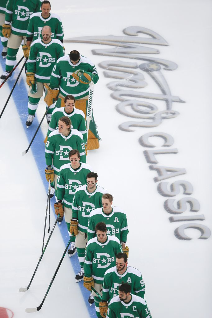 The Dallas Stars line up for the national anthem prior to a NHL Winter Classic matchup between the Dallas Stars and the Nashville Predators on Wednesday, January 1, 2020 at Cotton Bowl Stadium in Dallas. (Ryan Michalesko/The Dallas Morning News)