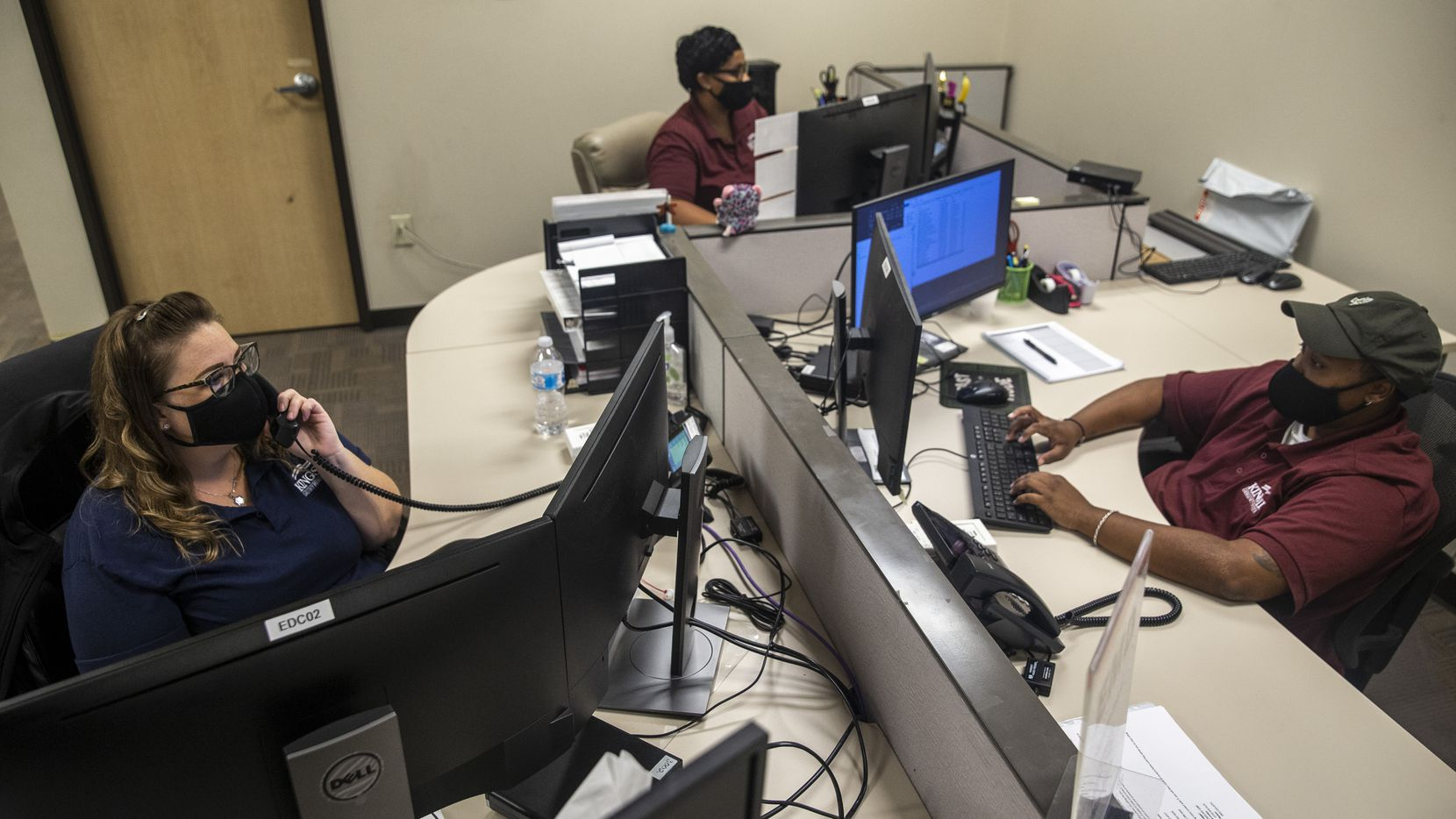 From left, clockwise, advanced emergency medical dispatchers Shayna Haden, Ronda Norsworthy, and Marshawn London work at the Kings III Emergency Communications call center in Coppell on Sept. 3.