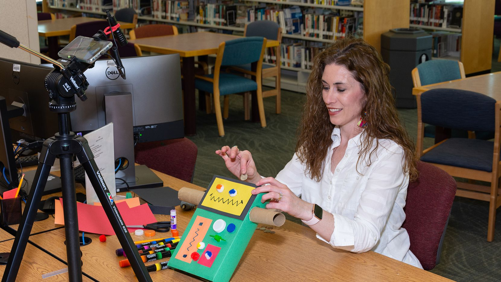 Librarian Melanie Storts demonstrates a craft for the Plano Public Library's Facebook programming.