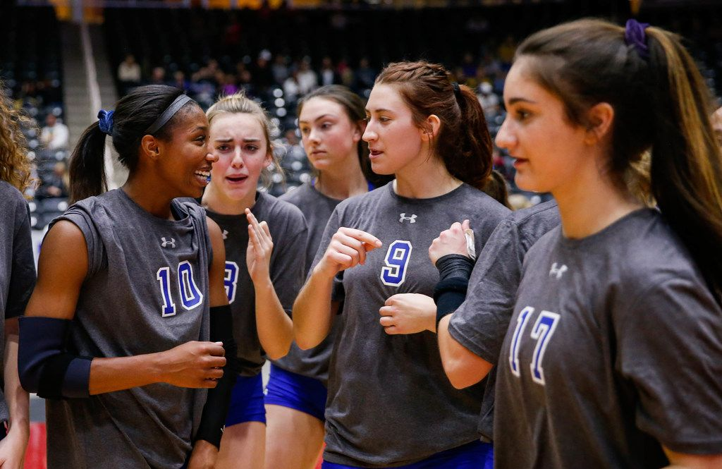 The Byron Nelson Bobcats celebrate after winning a class 6A volleyball state semifinal match against Schertz Clemens at the Curtis Culwell Center in Garland, on Friday, November 22, 2019. Nelson won the three sets 32-30, 25-22 and 25-14. (Juan Figueroa/The Dallas Morning News)
