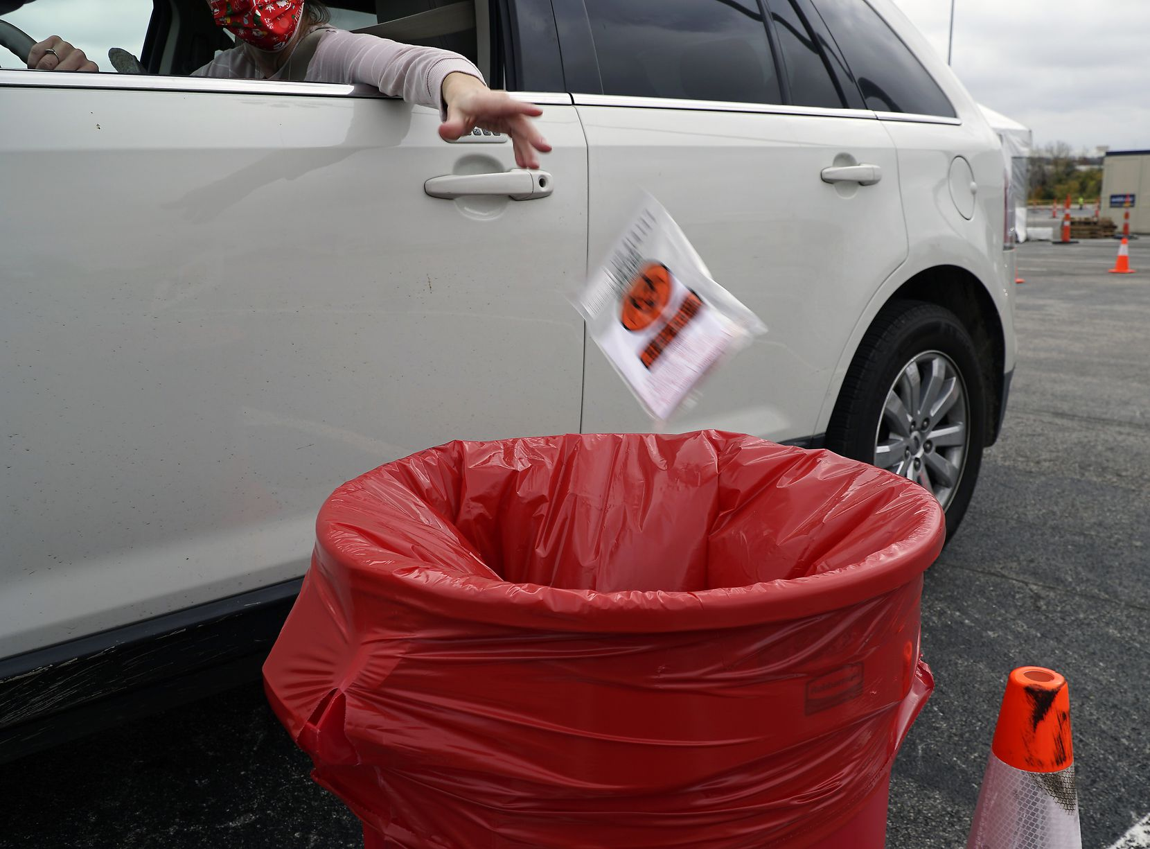 Self-administered mouth swabs being dropped off at a Curative site in the parking lot of Globe Life Stadium in Arlington on Dec. 19.