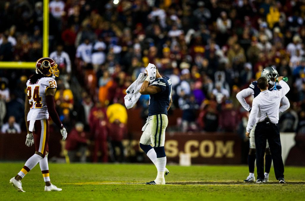 Dallas Cowboys quarterback Dak Prescott (4) wipes his head with a towel during a timeout in the fourth quarter of an NFL game between the Washington Redskins and the Dallas Cowboys on Sunday, October 21, 2018 in Landover, Maryland. (Ashley Landis/The Dallas Morning News)