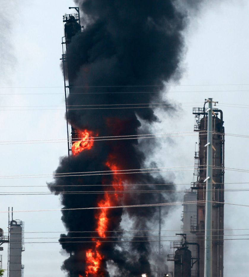 Flames and smoke rise after a fire started at an Exxon Mobil facility, Wednesday, July 31, 2019, in Baytown, Texas. (Yi-Chin Lee/Houston Chronicle via AP)
