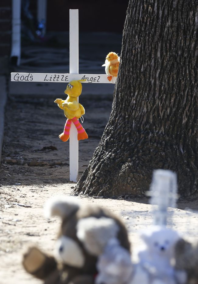 A memorial is seen Tuesday, Jan. 7, 2020, along the sidewalk of a home where a shooting left 1-year-old Rory Norman dead and wounded his uncle.