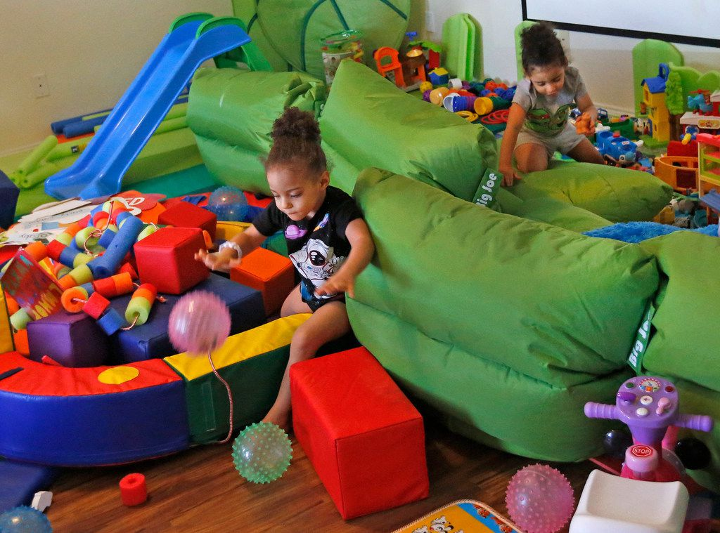Dallas Wings' player Glory Johnson's twin daughters Ava, left, and Solei play with their toys at their home in Arlington, Texas, on Saturday, June 30, 2018. (Louis DeLuca/The Dallas Morning News)
