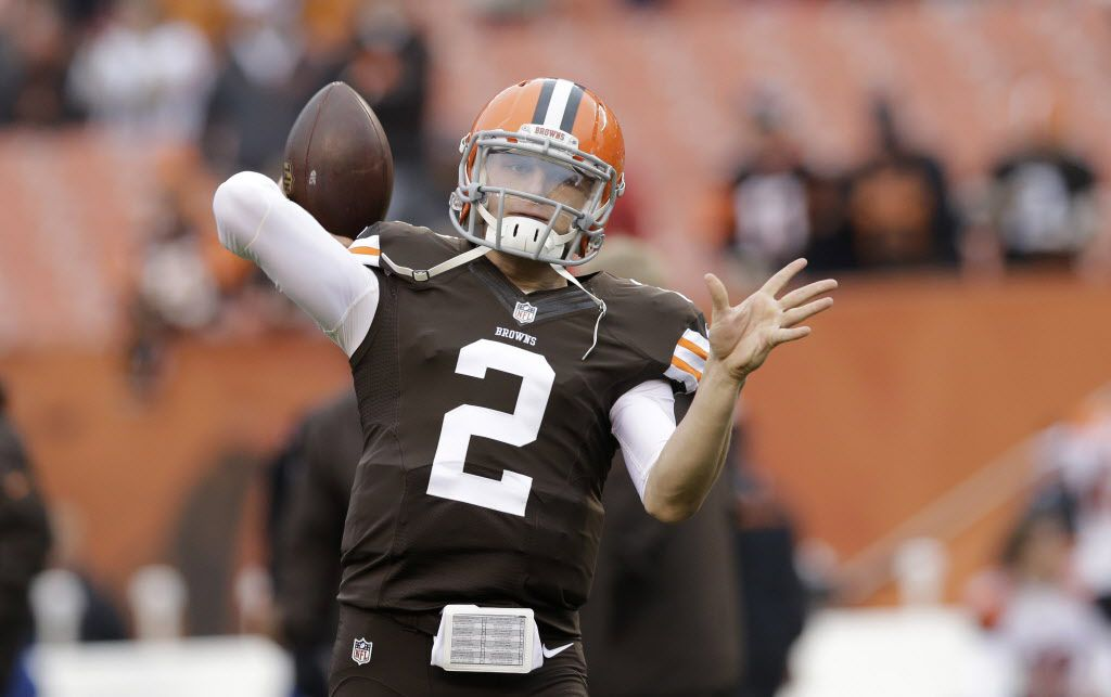 FILE - In this Dec. 14, 2014 file photo, Cleveland Browns quarterback Johnny Manziel warms up before an NFL football game against the Cincinnati Bengals  in Cleveland. A person familiar with the situation says Manziel has been released from a rehab facility. Manziel entered the undisclosed clinic Jan. 28 for treatment of an unspecified problem. The person said he was discharged Saturday, April 11, 2015, speaking on condition of anonymity because of privacy issues.  (AP Photo/Tony Dejak)