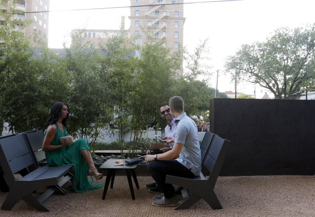 Tables get booked far in advance, but nearly half are held for walk-ins. Jacqueline Butler, Duncan McIntyre (front) and Tyson Butler wait on the patio for a table.