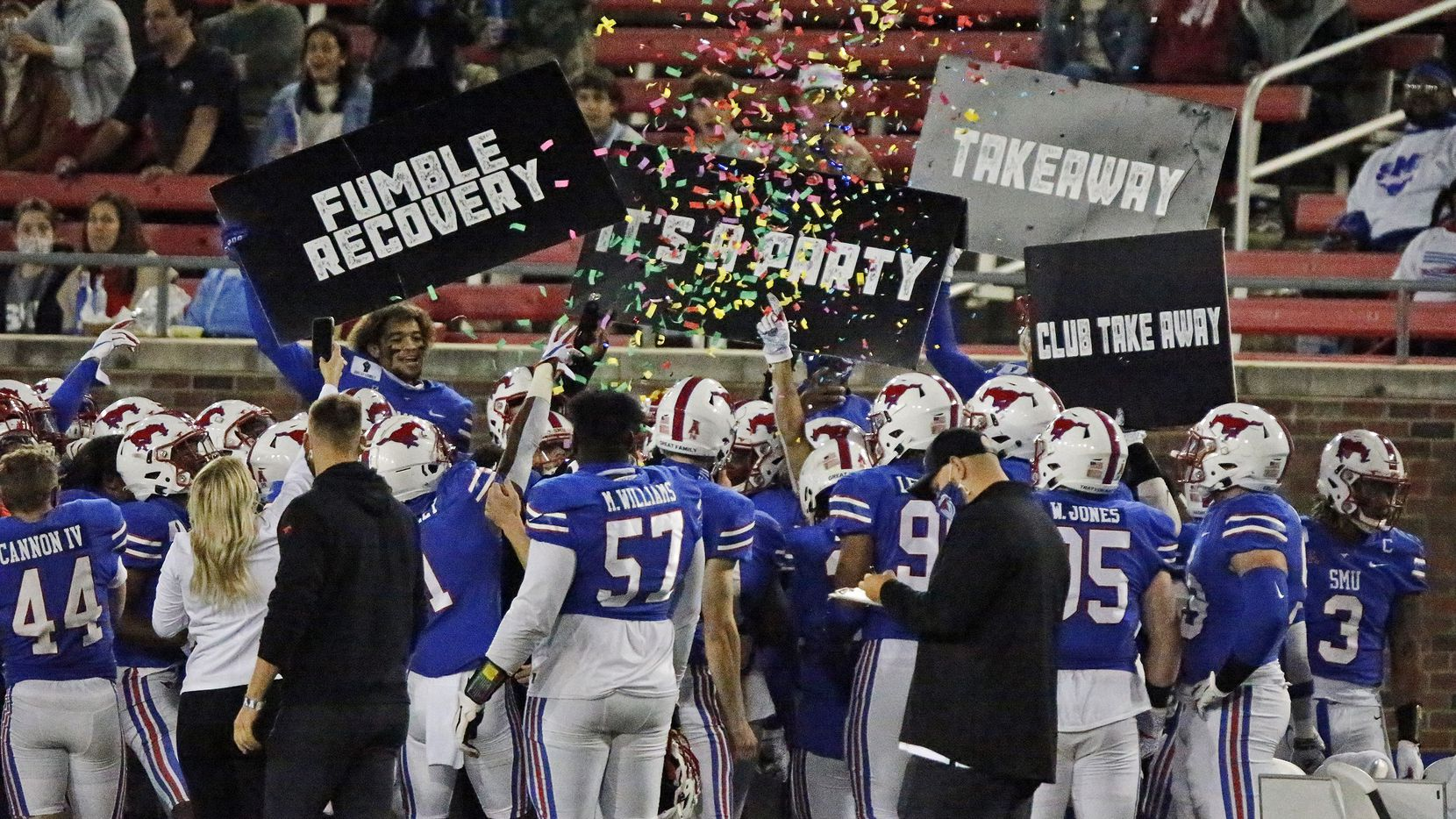 The SMU defensce celebrates on the sideline after a fumble recovery during the first half as SMU hosted Cincinnati University in an AAC football game at Ford Stadium in Dallas on Saturday night, October 24, 2020. (Stewart F. House/Special Contributor)
