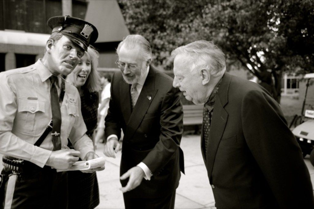 """Sculptor Seward Johnson, far right, observes one of his sculptures of a police officer, titled """"Time's Up,"""" at Rowan University in New Jersey. Johnson made seven molds of this sculpture, one of which stands outside the entrance of Central Market on Lovers Lane in Dallas.  (Time's Up by Seward Johnson  1983 The Seward Johnson Atelier Inc.)."""