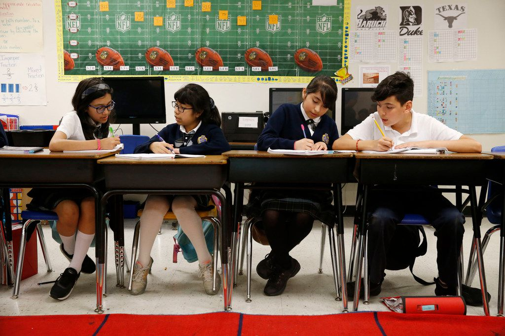 From left: Daniela Hernandez, Beatriz Ramirez, Briana Morales and Juan Pablo Ortiz work on math problems during class at Annie Webb Blanton Elementary in Dallas on May 17. Blanton Elementary is one of Dallas ISD's ACE schools where extra money and resources have been poured in to bolster struggling campuses.