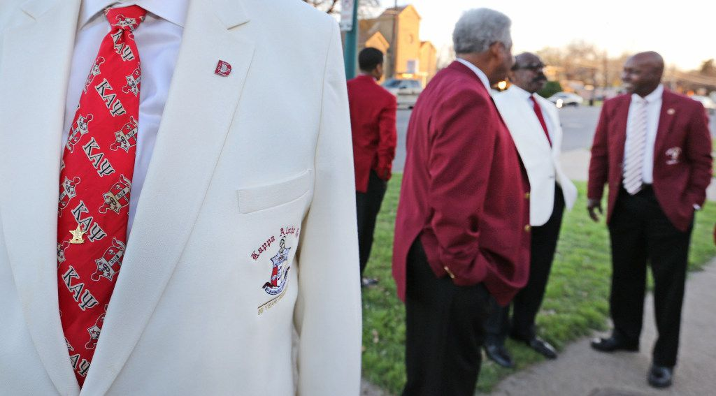 Kappa Alpha Psi 50-year member Stephen Washington displays his necktie as members gather at their chapter's house in South Dallas.