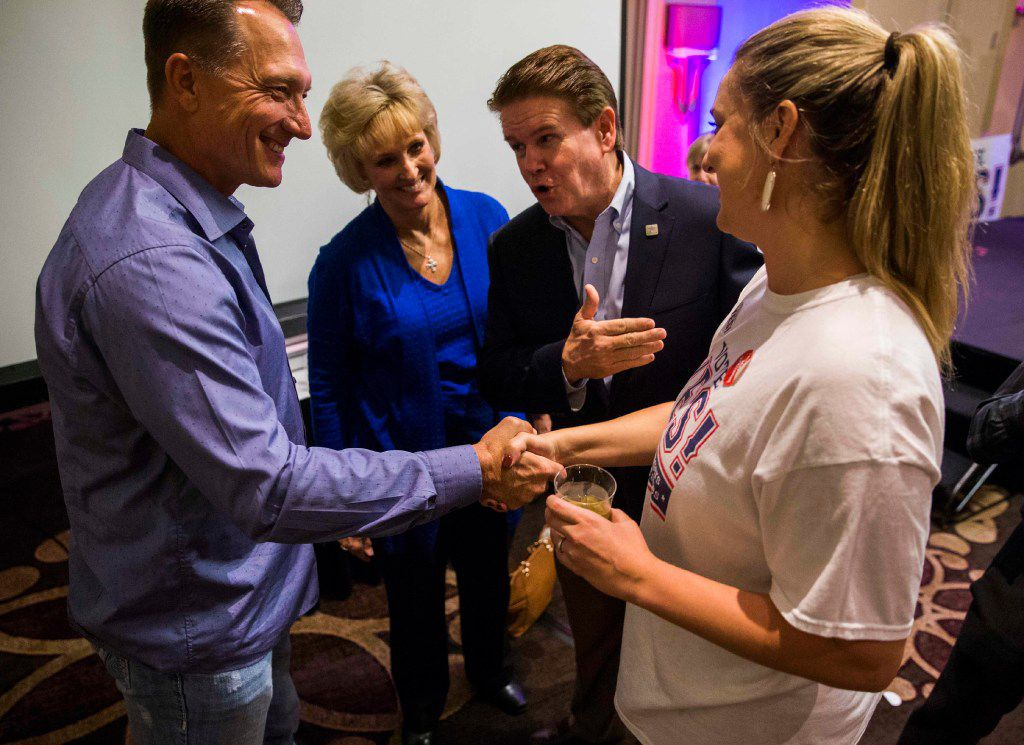 Arlington Mayor Jeff Williams (second from right) and his wife, Karen Williams, introduce campaign worker Holly Potter-Harvey (right) to Texas Rangers manager Jeff Banister as supporters of a new stadium for the Rangers celebrate after an election day victory on Nov. 8. (Ashley Landis/The Dallas Morning News)