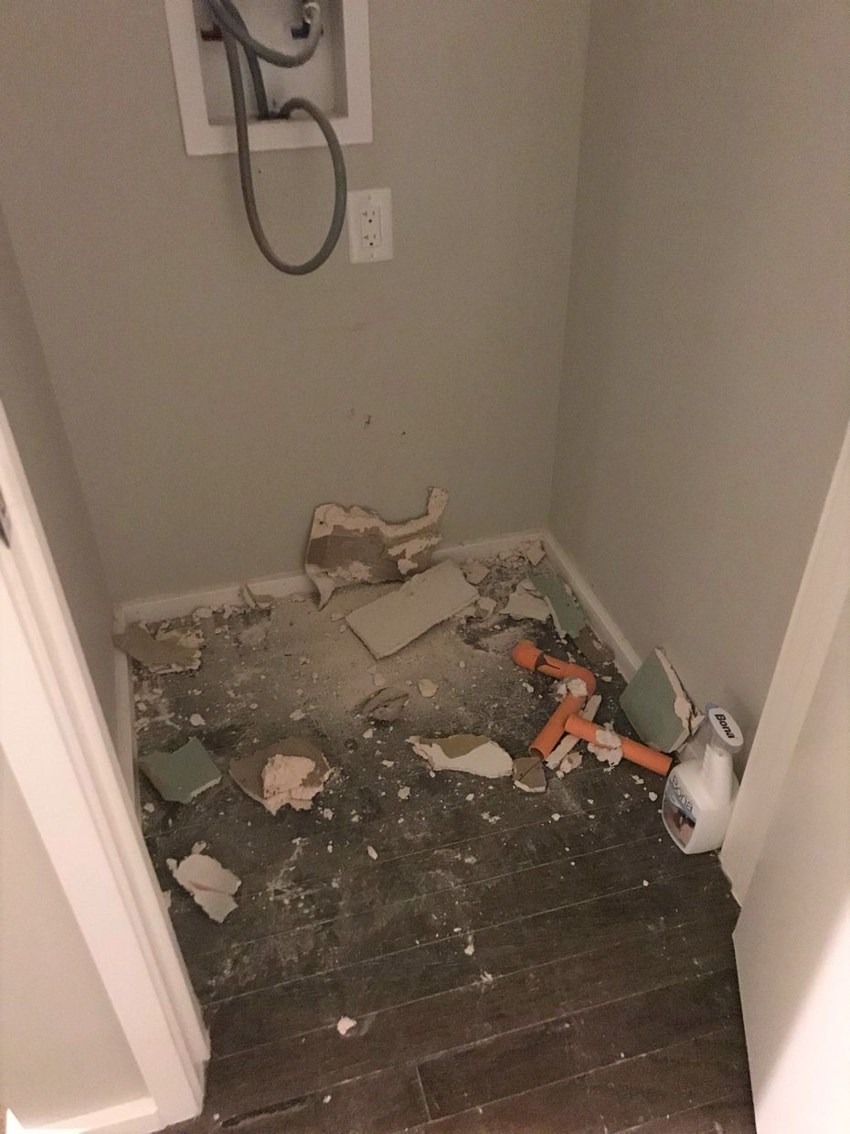 Remnants of pipe ripped out of a wall in one apartment shut down for sprinkler system repairs.