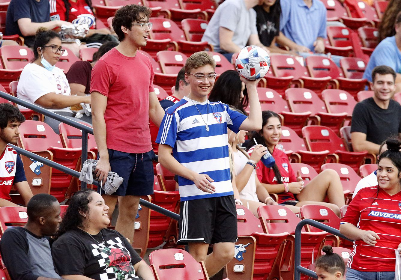 A fan winds up with an errant kick and tosses the ball back to the pitch during the first half as FC Dallas hosted the Seattle Sounders at Toyota Stadium in Frisco on Wednesday night, August 18, 2021. (Stewart F. House/Special Contributor)