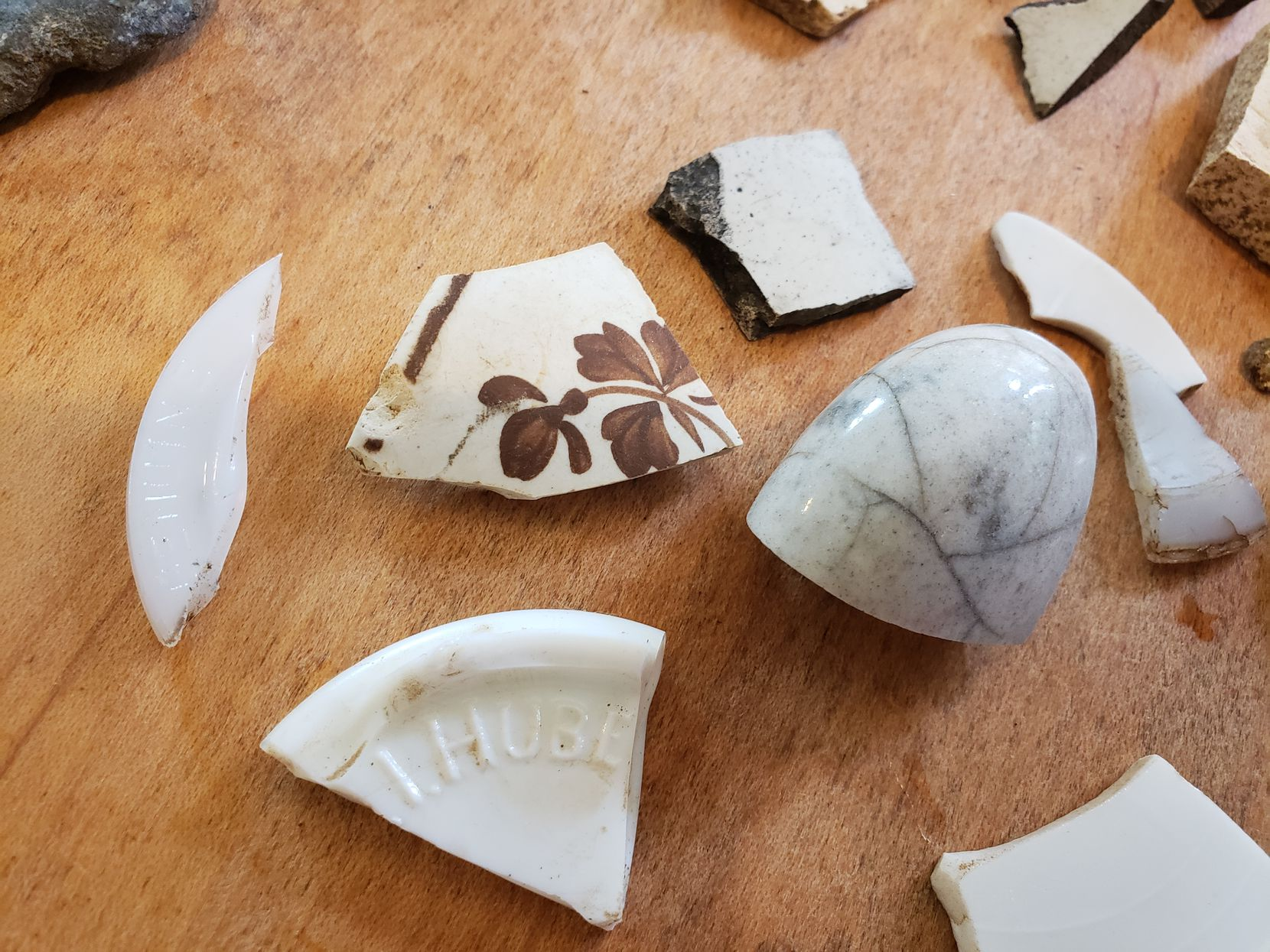 While excavating their yard for the family garden, the Marshes found pieces of pottery, possibly belonging to a farmhouse that may have stood on the property.