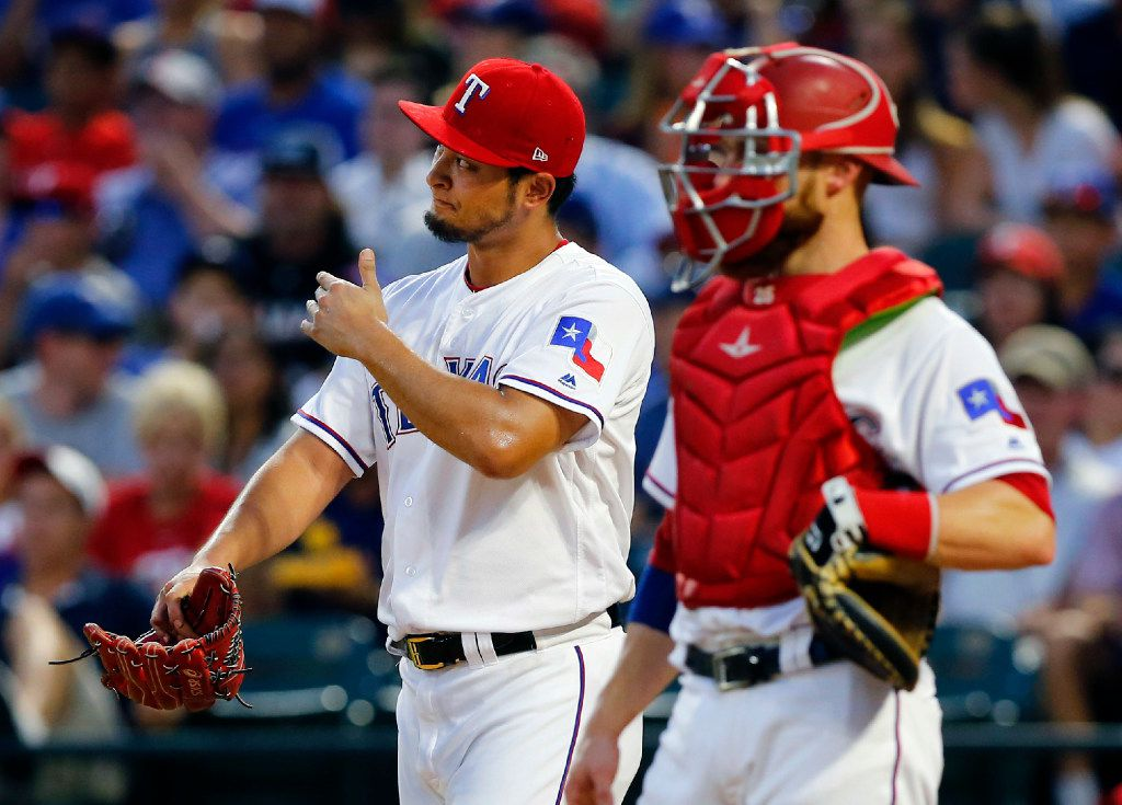 Texas Rangers starting pitcher Yu Darvish (left) reacts after Miami Marlins Marcell Ozuna's hit a three-RBI triple in the fourth inning at Globe Life Park in Arlington, Wednesday, July 26, 2017. Darvish gave up 7 runs in the inning. (Tom Fox/The Dallas Morning News)