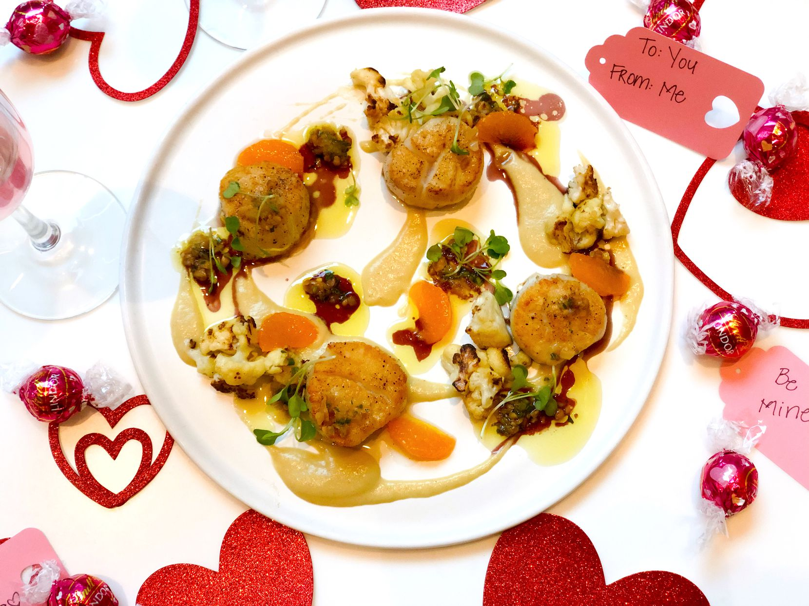 Sloane's Corner offers jumbo scallops served with roasted cauliflower, pine nuts and blood orange vinaigrette as part of its Valentine's Day menu.