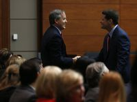 Texas Attorney General Ken Paxton shakes hands with his attorney Bill Mateja after entering the Merrill Hartman Courtroom in the Fifth Court of Appeals at the George Allen Courts Building in Dallas on May 12, 2016. Paxton was indicted in July 2015 but has not yet faced trial. (Rose Baca/The Dallas Morning News)