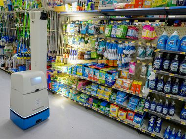 A robotic shelf scanner moves along an aisle at a North Richland Hills Walmart.
