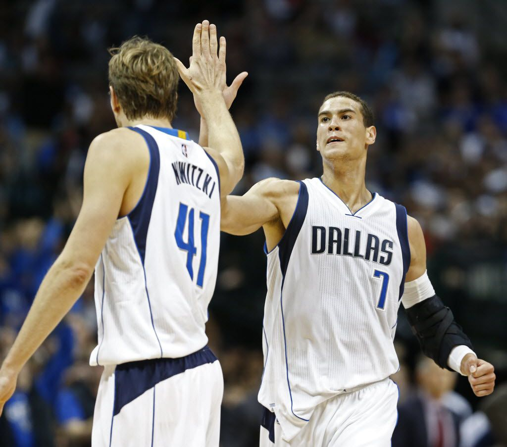 Dirk Nowitzki  and Dwight Powell celebrate after a shot against the Pelicans at American Airlines Center in Dallas November 7, 2015.   (Nathan Hunsinger The Dallas Morning News)
