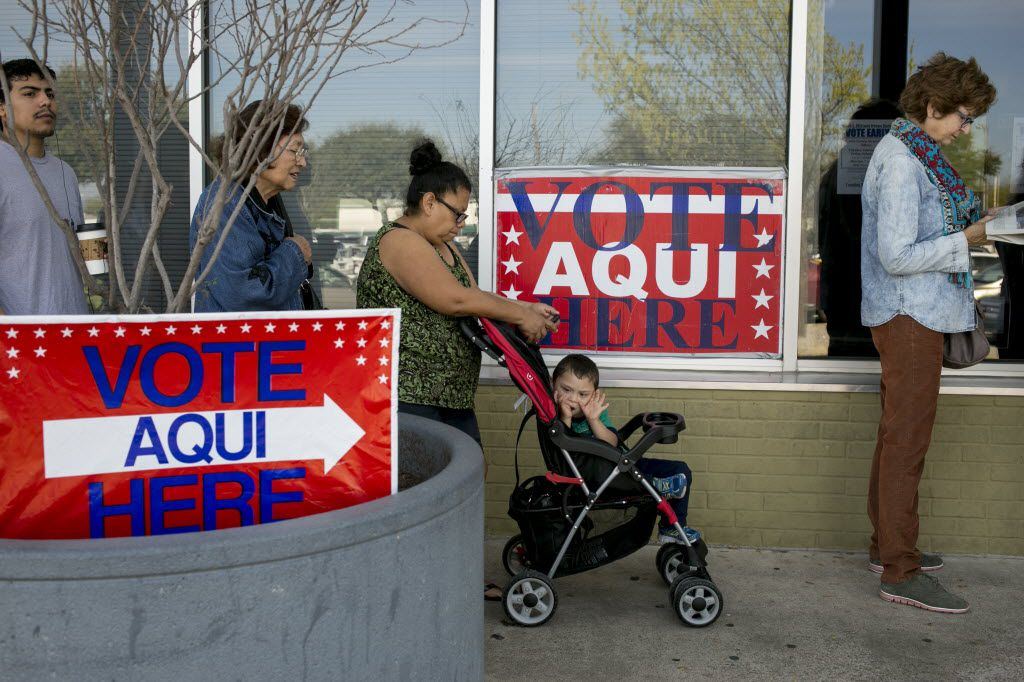 Marcelina Cavajal waited in line with her son, Anjelito Jaimes, 3, and other voters outside a polling station in Austin during the March 1 primary. (Ilana Panich-Linsman/The New York Times)