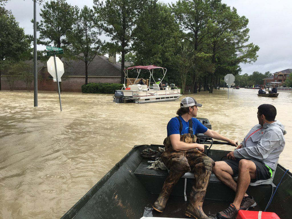 Dallas residents Josh Womack (left) and Sammy Abdullah drove to Houston with a john boat Monday, Aug. 28, 2017 to take part in search and rescue efforts. They are shown here in the Kingwood neighborhood of Houston on Tuesday, Aug. 29, 2017 in the wake of Hurricane Harvey.