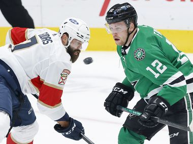A shot comes flying past Dallas Stars center Radek Faksa (12) and Florida Panthers defenseman Radko Gudas (7) in the first period at the American Airlines Center in Dallas, Tuesday, April 13, 2021.