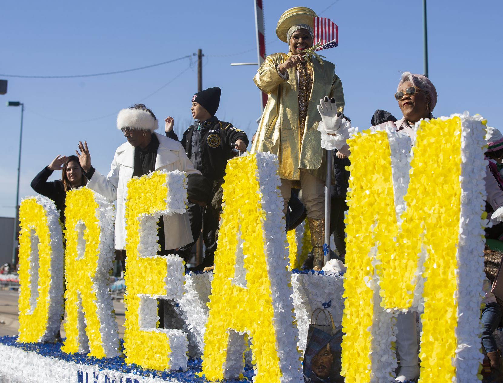 The MLK Board waves as they make their way down Martin Luther King Jr. Blvd during the 38th annual MLK Parade on Jan. 20, 2020 in Dallas.