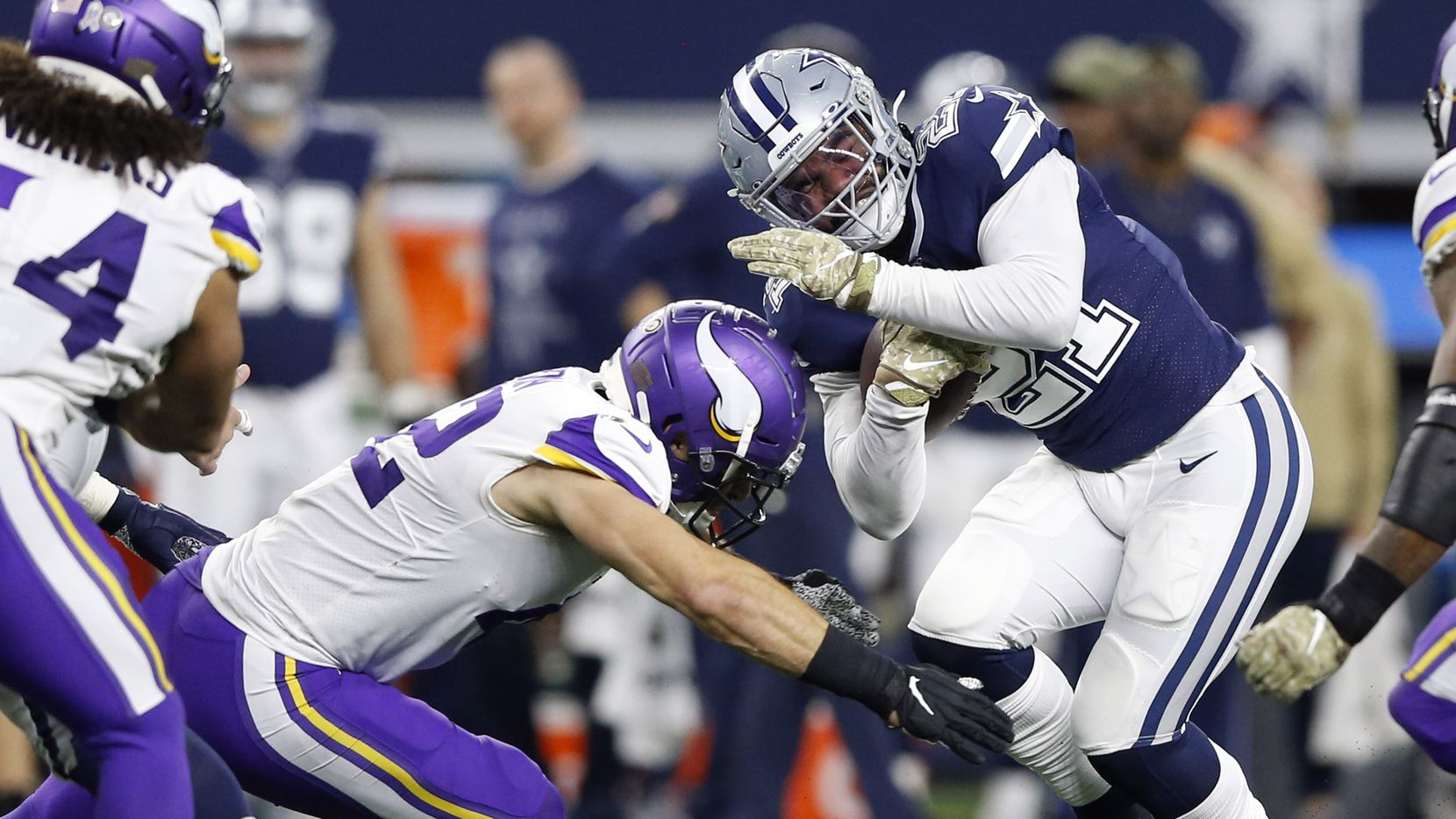 Dallas Cowboys running back Ezekiel Elliott (21) is tackled by Minnesota Vikings outside linebacker Ben Gedeon (42) on a run play during the second half of play at AT&T Stadium in Arlington, Texas on Sunday, November 10, 2019. The Minnesota Vikings defeated the Dallas Cowboys 28-24. (Vernon Bryant/The Dallas Morning News)