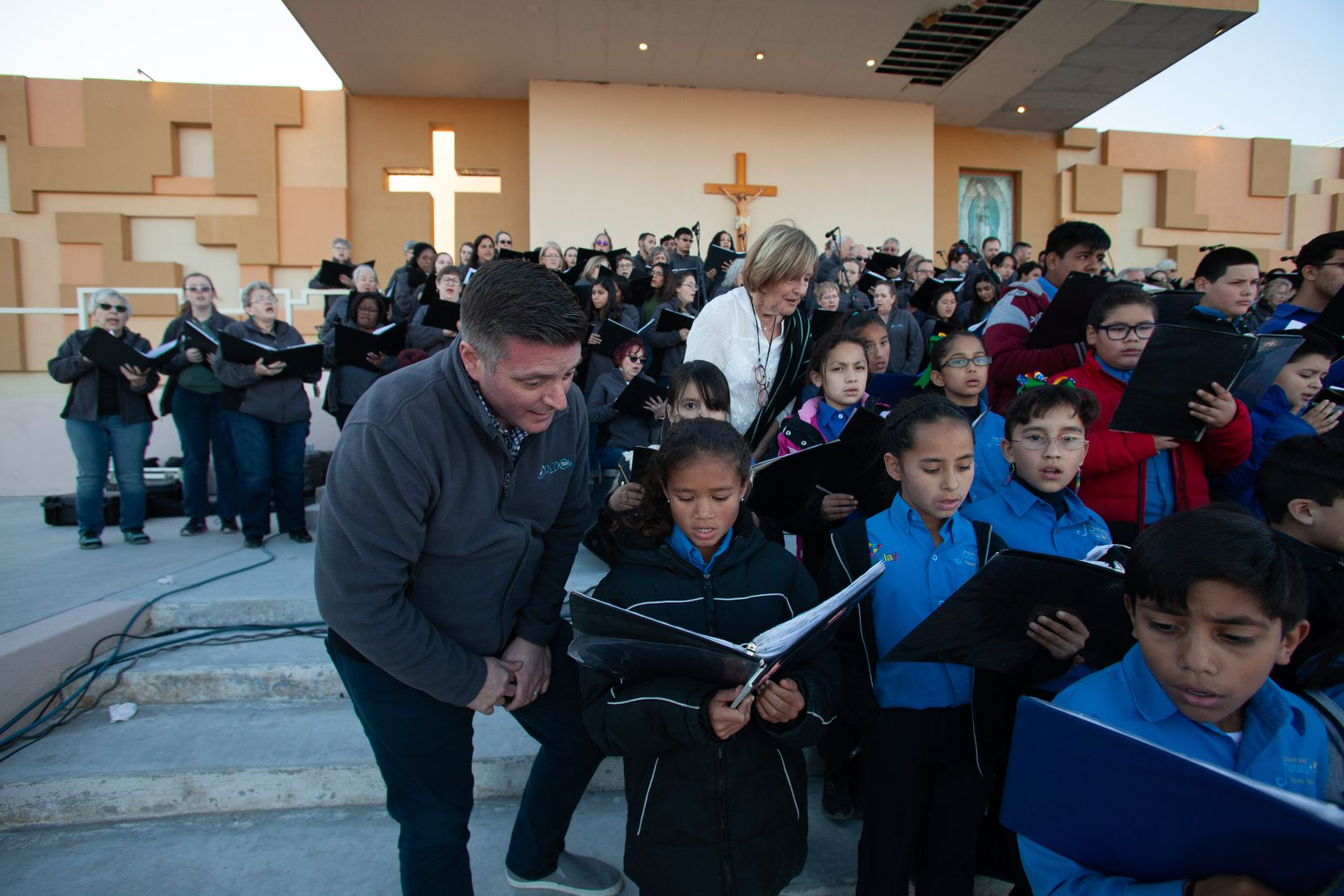 Jonathan Palant, University of Texas at Dallas Choral Director, sings on January 18 with a choir member of Esperanza Azteca Youth Choir at a binational Music Festival in Juárez at El Punto, an outdoor venue constructed for Pope Francis' 2016   visit.
