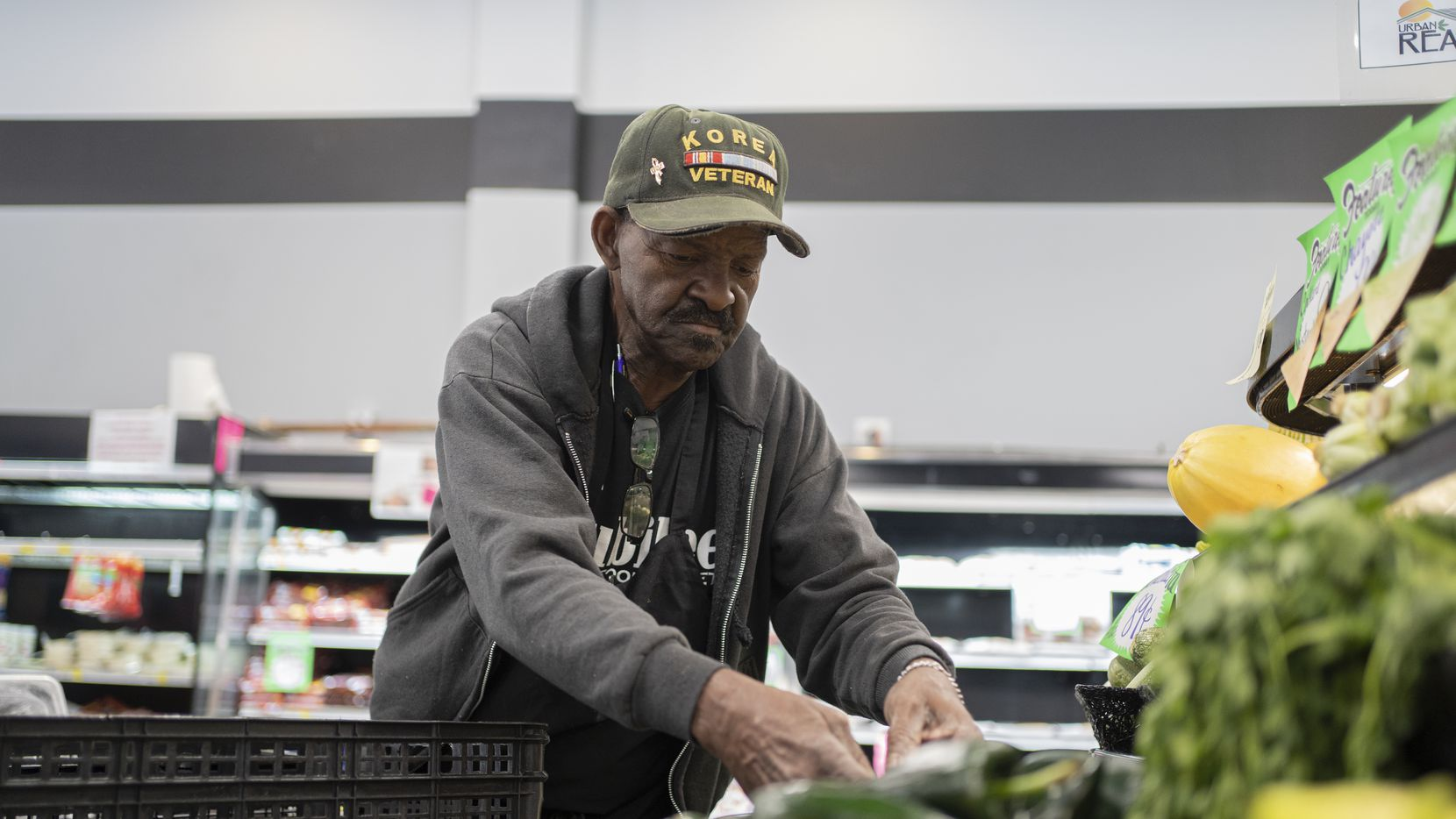 """Produce Manager David Daniels stocks vegetables at Jubilee Market, a one-of-a-kind, non-profit grocery store, just 10 minutes away from Baylor University in North Waco. Daniels grew up in this low-income neighborhood. He says Jubilee, which opened in 2016, is the first """"real"""" grocery store for this community."""
