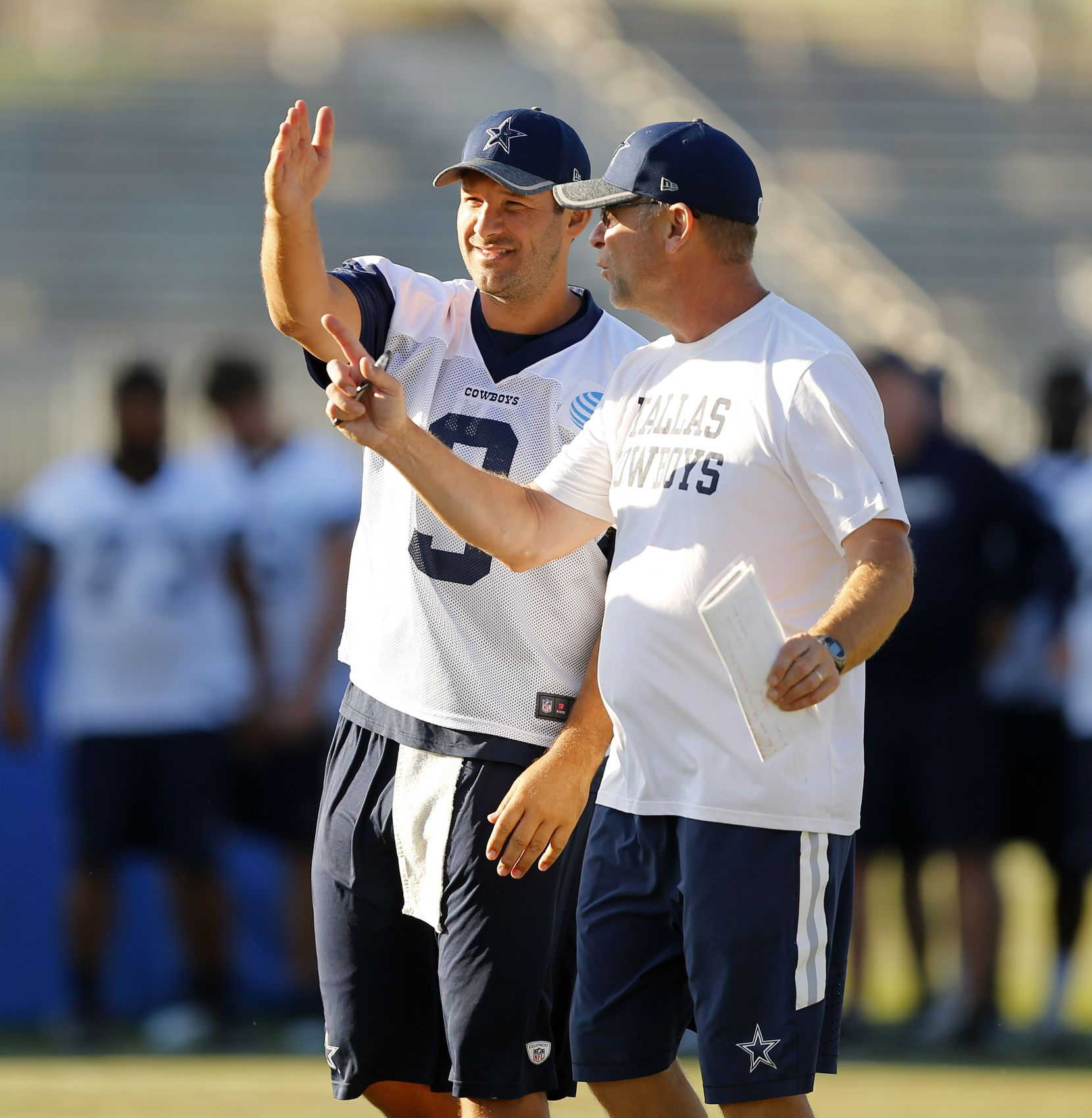 Dallas Cowboys quarterback Tony Romo (9) and offensive coordinator Scott Linehan talk about last second plays during afternoon an walk thru at training camp in Oxnard, California, Thursday, August 11, 2016. (Tom Fox/The Dallas Morning News)