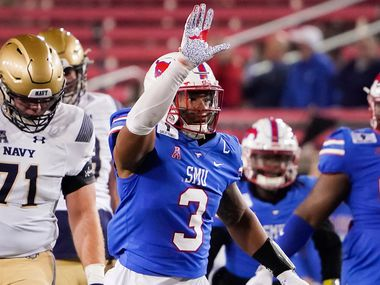 SMU linebacker Delano Robinson (3) celebrates after sacking Navy quarterback Dalen Morris (8) during the third quarter of an NCAA football game at Ford Stadium on Saturday, Oct. 31, 2020, in Dallas. (Smiley N. Pool/The Dallas Morning News)