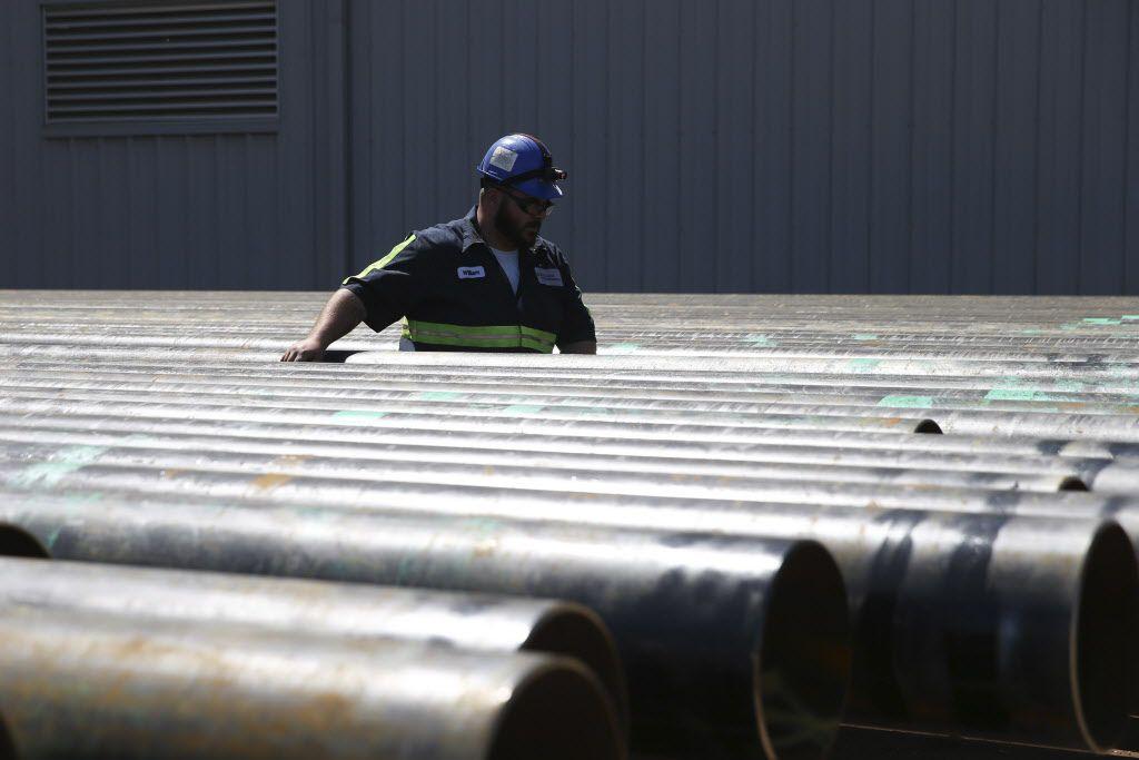 William Hampton walks between steel pipes at the Borusan Mannesmann plant in Baytown.