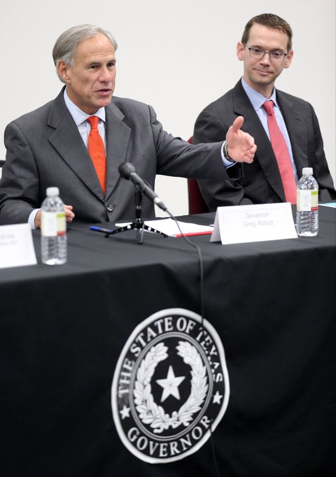 Governor Greg Abbott (left) and Texas Education Agency Commissioner Mike Morath meet with teachers and school administrators during a visit to Dallas ISD Solar Preparatory School for Girls on Tuesday, August 21, 2018 in Dallas. (Ryan Michalesko/The Dallas Morning News)