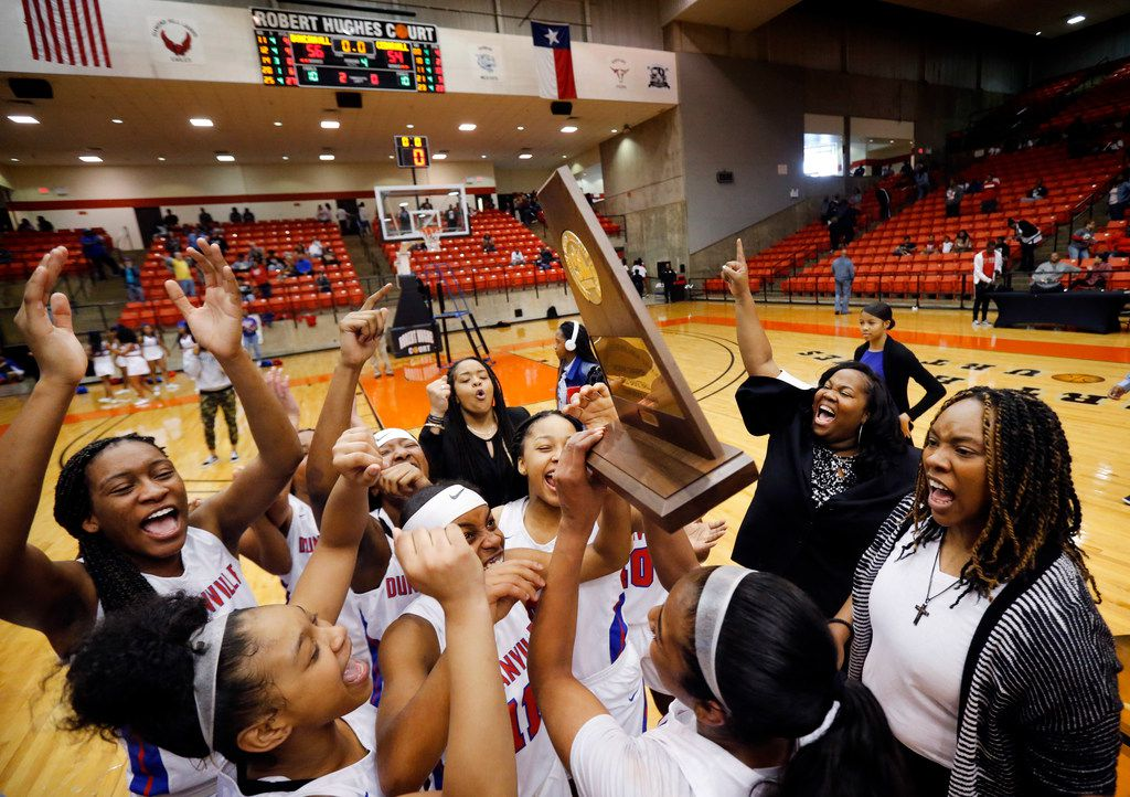 Duncanville's head coach Lajeanna Howard (right) and her players celebrate their Class 6A Region I championship over Cedar Hill at Wilkerson-Greines Activity Center in Fort Worth, Saturday, February 29, 2020. Duncanville won the title game, 56-54.