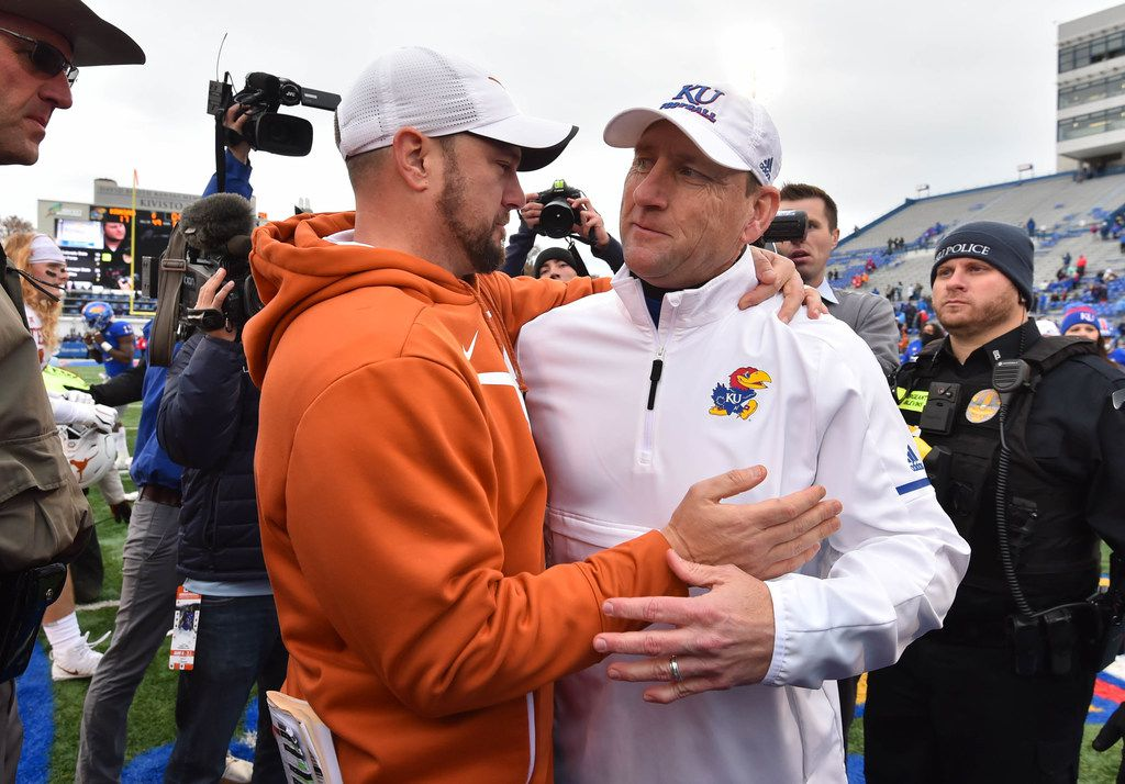 Head coach Tom Herman of the Texas Longhorns and head coach David Beaty of the Kansas Jayhawks greet each other after Texas' 24-17 win at Memorial Stadium on November 23, 2018 in Lawrence, Kansas. (Photo by Ed Zurga/Getty Images)