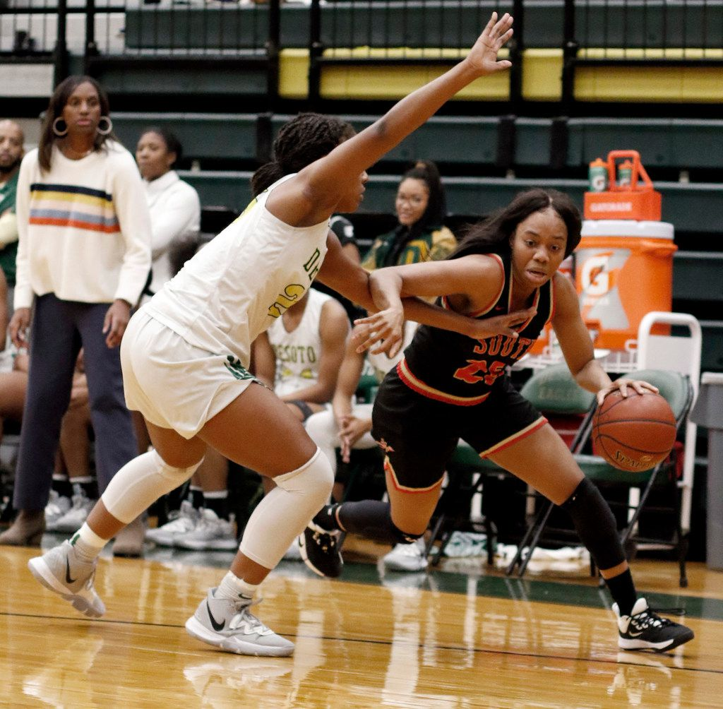 South Grand Prairie's Madison Jean-Louis (25) drives against the aggressive defense of DeSoto's Ash'a Thompson (25) during first half action. The two teams played their District 7-6A girls basketball game at DeSoto High School in DeSoto on January 21, 2020. (Steve Hamm/ Special Contributor)