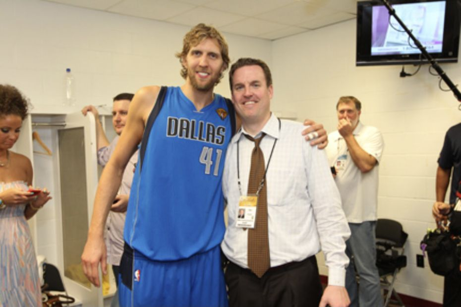 Dirk Nowitzki and Tim Frank, now the NBA senior vice president of basketball communications, pose in the locker room at AmericanAirlines Arena after the 2011 NBA Finals.