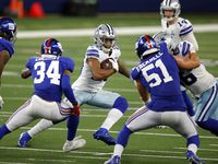 Dallas Cowboys running back Tony Pollard (20) cutback against the New York Giants defense as he takes the handoff from quarterback Andy Dalton (14) in the fourth quarter at AT&T Stadium Stadium in Arlington, Texas, Sunday, October 11, 2020. The Cowboys defeated the Giants on a last second field goal, 37-34.
