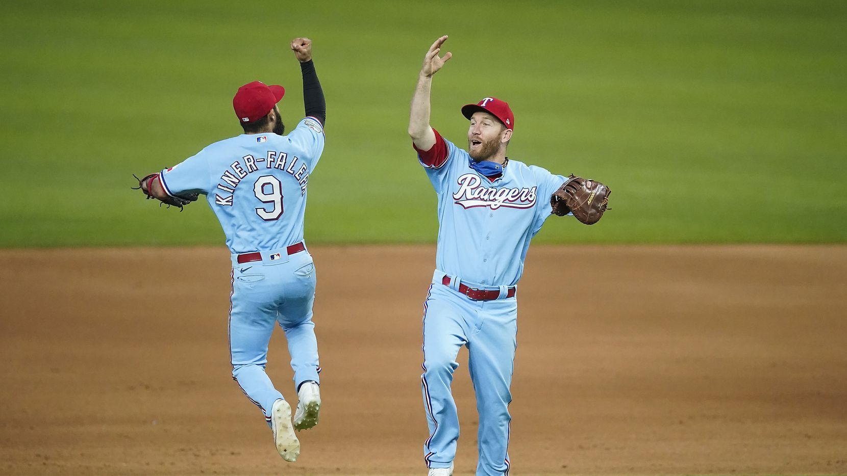 Texas Rangers third base Isiah Kiner-Falefa celebrates with first baseman Todd Frazier after a 7-3 victory for a series sweep of the Los Angeles Angels at Globe Life Field on Sunday, Aug. 9, 2020.