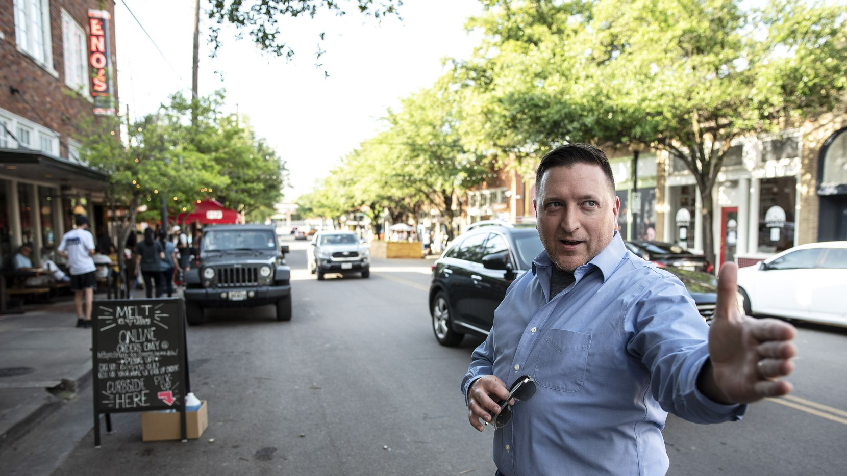 Shane Spillers, co-owner of Eno's Pizza Tavern, explains where he plans to have a parklet outside of his business on Bishop Avenue in Dallas, Friday, May 15, 2020. The city will offer permits for temporary parklets, or outdoor seating areas that spill onto streets where cars would normally park.